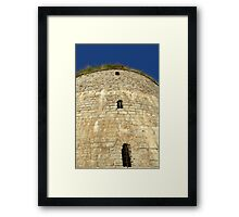 Old tower against the blue sky Framed Print