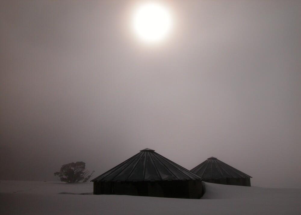 Shrouded Sun over Snowbound Water Tanks by John Barratt