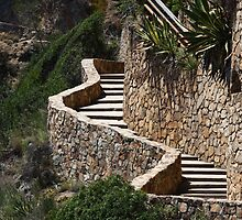 winding stone staircase in the mountains by mrivserg