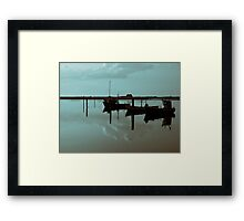 Magical reflection of a small dinghy dory boats Framed Print