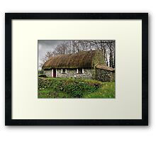 Old tatched Irish country famine cottage Framed Print