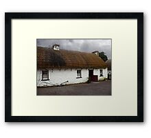Old tatched and whitewashed Irish country cottage Framed Print