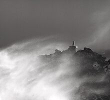 Raging seas towering above the coastline by miradorpictures
