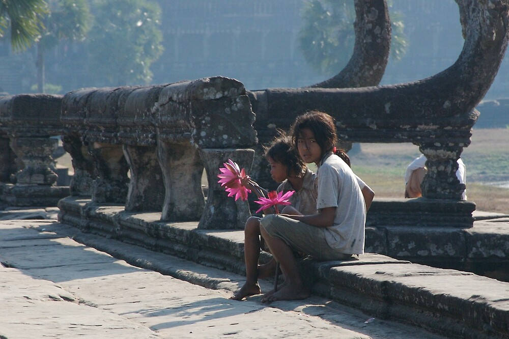 Girls at Angkor Wat temple by Mark Mansour