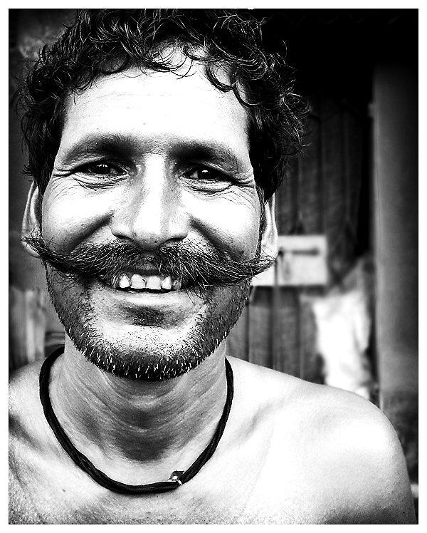 Pauper's Smile by burstbubble