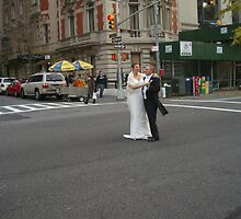 Wedding Couple Dancing on 5th Avenue New York by Johny Bloggs