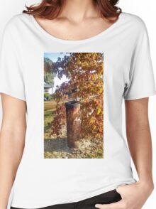 Weathered Fencepost with Tire Top Next to Autumn shrub Women's Relaxed Fit T-Shirt