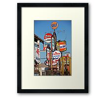 Many signs Framed Print