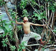 Iban boy looking for fruit by fishknox