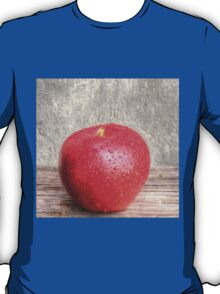 Apple with water drops on table T-Shirt