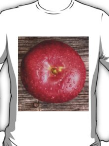 Apple with water drops on table 2 T-Shirt
