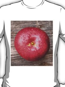 Apple with water drops on table 3 T-Shirt