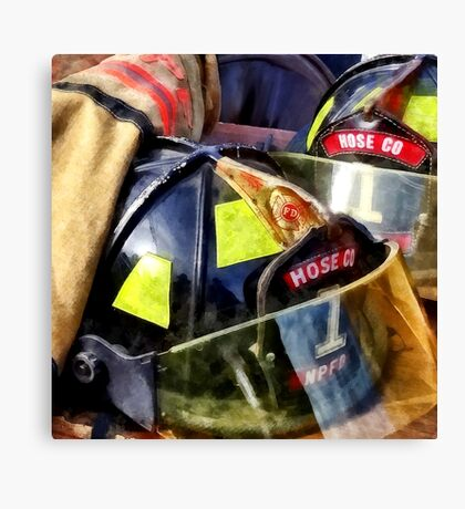 Two Fire Helmets and Fireman's Jacket Canvas Print