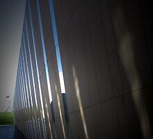 A wall with glass by Mark Braham