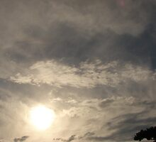 sun in clouds by Rosemarie