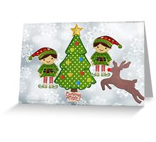 Elves with reindeer at the tree Greeting Card
