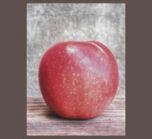 Red apple on grunge background 2 Kids Clothes