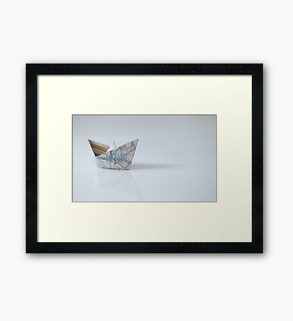 Paper ships from the map Framed Print