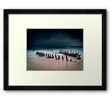 A beach with water Framed Print