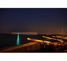 Red Jet 4 passing Cowes at Night Photographic Print