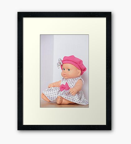 doll with pink bow Framed Print
