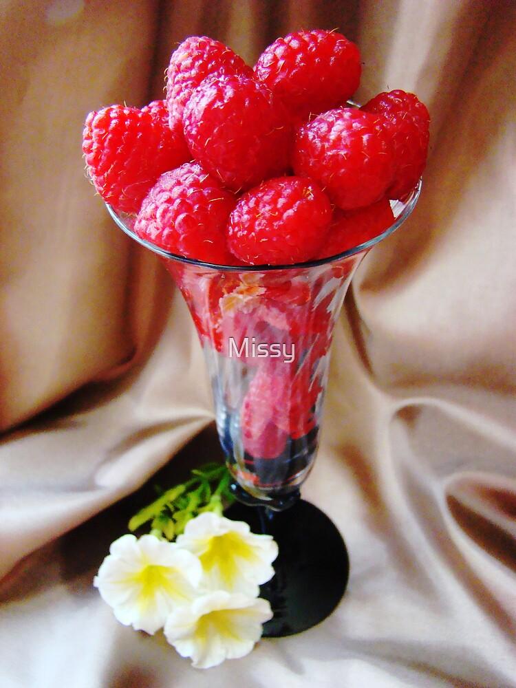 Rasberries in a glass by Missy