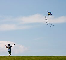 a boy and his kite by Gleb Zverinskiy