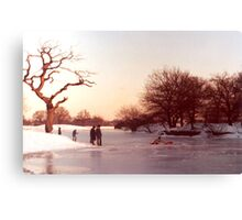 A child retrieves a lost sledge from the ice Canvas Print