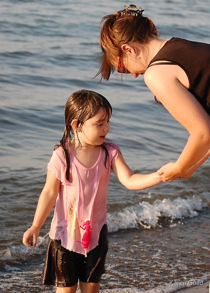 Sharing beach treasures by Karen Goad
