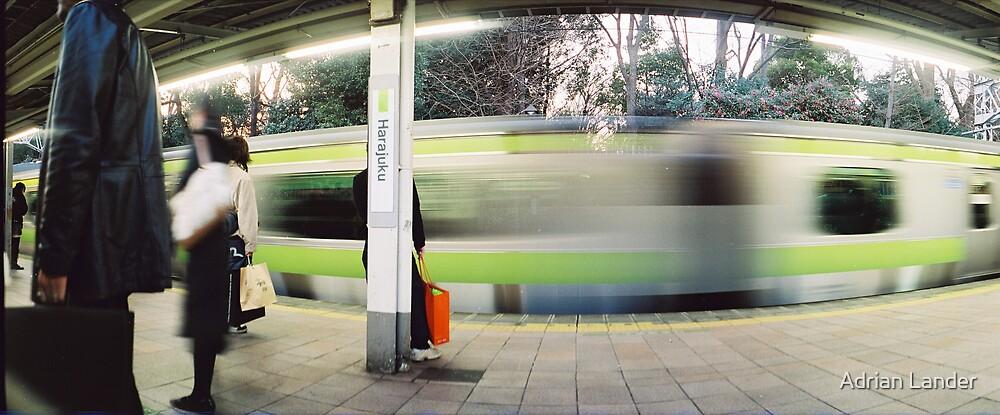 Tokyo train by Adrian Lander