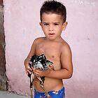 Little Cuban boy with chicken by Bill Knapp