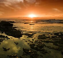 Beautiful seascape in dramatic sunset by Ron Zmiri