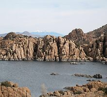 Lake with rocks and Mountains with snow by reddog176