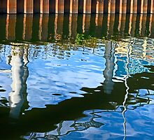 Ripples under the bridge by cclaude
