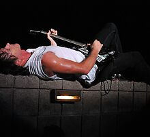 Rick laying on stage by daydremr