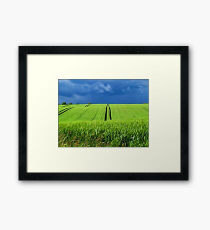 Green grass field with dramatic beautiful sky background Framed Print