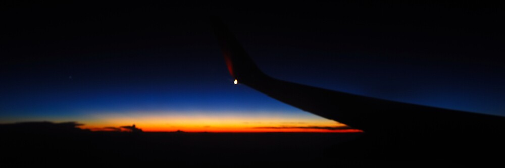 Sunset from a plane by cruffo