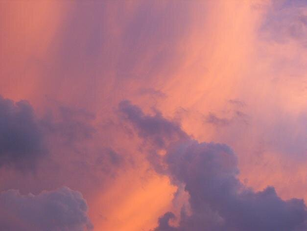 clouds over sunset by alina roberts