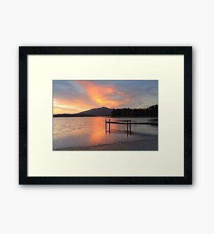 Sunset over lake with old jetty Framed Print