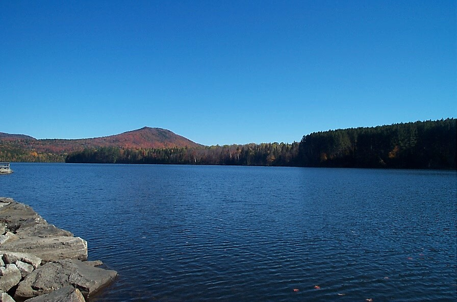 Placid lake in Maine. by Larry