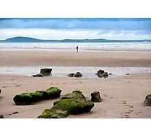 lone girl walking near unusual mud banks Photographic Print