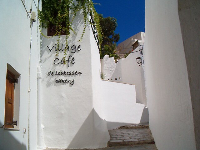 The village cafe in Lindos, Rhodes by Lynn Francis
