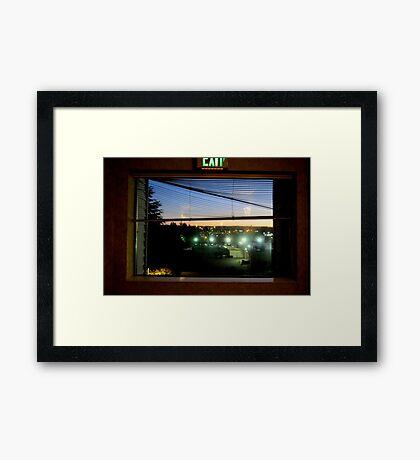 Through The Motel Hallway Window Framed Print