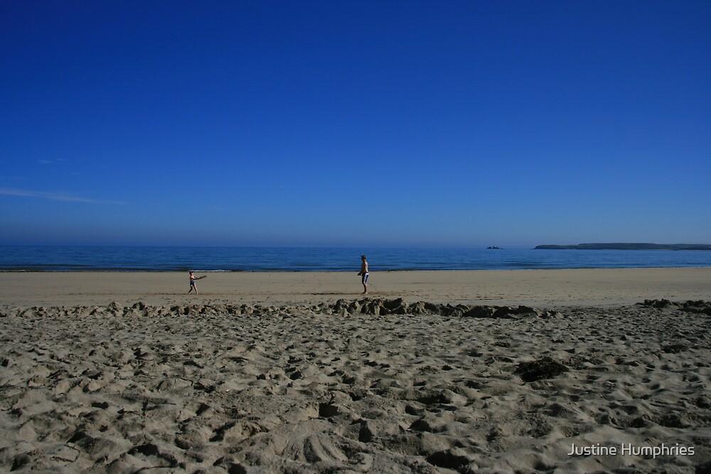 Blue sky beach by Justine Humphries