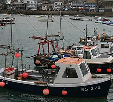 Fishing boats all in a row by Justine Humphries