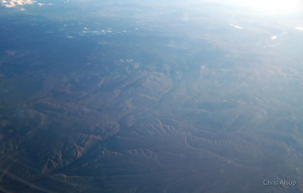Mountins and hills at 37000 feet by Chris Alsup