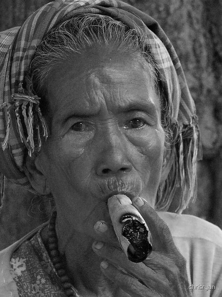 Burmese Woman smoking cheroot by chrisryan
