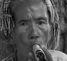 Burmese Woman smoking cheroot by chrisryan