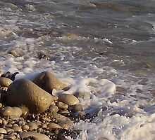 Pebbles and foam by JeanEdgell