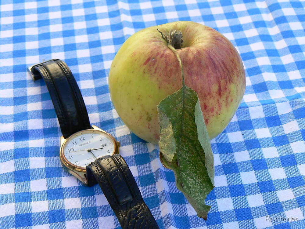apple time sitting on a blue and white checkerd back ground by Rexcharles